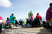 Young people on terrace of Cafe No Name, Flims Laax Falera ski area, Laax, Grisons, Switzerland
