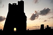 Aberystwyth castle tower ruins at sunset, Wales UK