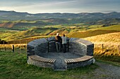 A couple of tourists admiring the view of north powys from the Wynford Vaughan Thomas memorial viewpoint near Machynlleth mid wales UK