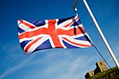 Union Flag Flying on the Quayside with St Marys Church Beyond Whitby North Yorkshire England