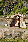 War Memorial set in an alcove in rock below the Castle Bamburgh Northumberland England