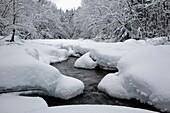 Swift River during the winter months This river runs along the side of the Kancamagus Highway route 112 which is one of New England's scenic byways Located in the White Mountains, New Hampshire USA