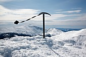 The summit of Mount Adams during the winter months in the White Mountains, New Hampshire USA Mount Washington is in the distance