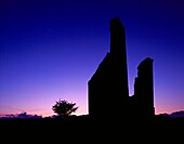 Silhouette of an old engine house ruin at the New Phoenix Mine, also known as the Silver Valley Mine, on Bodmin Moor, Minions, Cornwall, England, United Kingdom