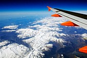 Aerial view of the Pyrenees Mountains in Andorra from 38, 000 feet Viewed from a passenger aeroplane with it's wing clearly visible