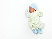 Newborn child baby boy asleep isolated on white background
