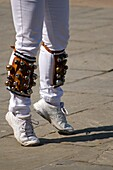 Detail of Morris dancers,  legs in action with bells on