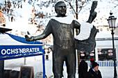 Snow-covered statue of Roider Jackl at Viktualienmarkt, Munich, Bavaria, Germany