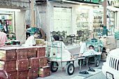 Workers having a rest at an oriental bazar, Dubai, United Emirates