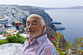 Actor Mario Adorf on a terrace near Fira, (on the occasion of shooting for ARD Degeto-Mona Film Production) Santorini, Greece, Europe