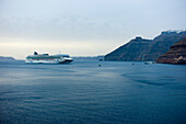 Norwegian Cruise Line lying at anchor at dusk, Cruiseship Norwegian Gem, Santorini, Greece, Europe