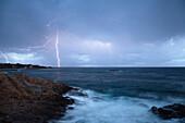 Thunderstorm and surf in Algajola Bay, North-west coast, Balagne region, Corsica, France, Europe