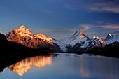 Lake Bachsee with alpenglow at Wetterhorn, Lauteraarhorn, Schreckhorn and Finsteraarhorn, Bachsee, Grindelwald, UNESCO World Heritage Site Swiss Alps Jungfrau - Aletsch, Bernese Oberland, Bern, Switzerland, Europe