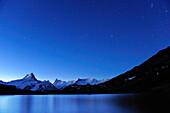 Starry sky above lake Bachsee with Lauteraarhorn, Schreckhorn, Finsteraarhorn and Fiescherhorn, Bachsee, Grindelwald, UNESCO World Heritage Site Swiss Alps Jungfrau - Aletsch, Bernese Oberland, Bern, Switzerland, Europe