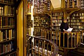 Monk at the library at Maria Laach abbey, Eifel, Rhineland-Palatinate, Germany, Europe