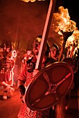 Up Helly Aa fire procession LERWICK SHETLAND Guizer Jarl Einar of Gullberuviks Vikings escorting Viking longship galley