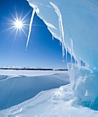 melting Arctic ocean ice in spring in Lancaster Sound, north west passage Nunavut, Deep blue ice is usually glacial in origin and once part of much larger icebergs Some scientists believe that the Arctic could be ice free by 2050 due to impact of climate
