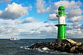 Green-white lighthouse on the mole of Warnemuende, Rostock-Warnemuende, Mecklenburg-Western Pomerania, Germany