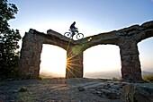 Mark Weber sunset mountain biking at Knapps Castle in the Santa Ynez Mountains above the city of Santa Barbara in southern California USA