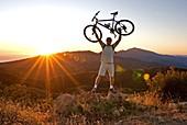 Mark Weber mountain biking at sunset in the Santa Ynez Mountains near the city of Santa Barbara in southern California USA