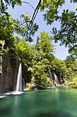 The Plitvice Lakes in the National Park Plitvicka Jezera in Croatia The upper lakes, ponds and waterfalls with lush vegetation The Plitvice Lakes are a string of lakes connected by waterfalls They are in a valley, which becomes a canyon in the lower pa