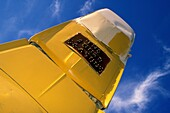 A yellow car namedThe Fourd Seasons,  juts out of the ground at Carhenge, near Alliance, Nebraska, USA, 2004  Carhenge is a replica of England's Stonehenge located near the city of Alliance, Nebraska on the High Plains Instead of being made from stones