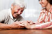 Senior and mature women holding hands, Zurich, Switzerland