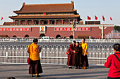 Tibetan monks and nuns on Tiananmen Square, taking pictures, Gate of Heavenly Peace, Mao Zedong, Beijing, People's Republic of China