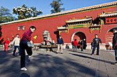 Morning sport in Jingshan Park at the northern gate, group playing badminton using their feet, exercise early in the morning, Beijing, People's Republic of China