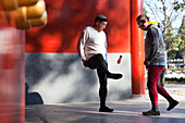 Morning sport in Jingshan Park, two old men playing badminton with their feet, red walls, western gate, Beijing, People's Republic of China