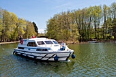 Houseboat on lake Zechliner near Zechlinerhütte, North Brandenburg Lake District, Brandenburg, Germany
