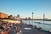 People on stairs at Rhine promenade, Düsseldorf, Duesseldorf, North Rhine-Westphalia, Germany, Europe