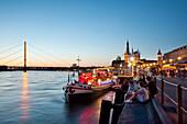 Restaurant on a ship at Rhine promenade in the evening, Düsseldorf, Duesseldorf, North Rhine-Westphalia, Germany, Europe