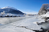 River Inn with ice-covered bank and La Punt-Chamues-ch in background, La Punt, Upper Engadin, Engadin, Grisons, Switzerland, Europe