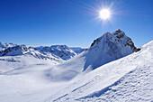 Sun above Corn Alv in winter landscape, Julierpass, Albula range, Upper Engadin, Engadin, Grisons, Switzerland, Europe