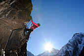 Woman climbing overhang in fixed rope route, Schiestl-via ferrata, fixed rope route, Laengenfeld, valley of Oetztal, Oetztal range, Tyrol, Austria, Europe