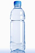 Bottle of Mineral Water Against a White Background, Close Up
