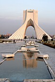 The Azadi Tower, or King Memorial Tower, is the symbol of Teheran, Iran, and marks the entrance to the metropolis, Iran