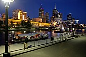 Boat embarking from Southbank and the Melbourne Skyline at night, Victoria, Australia