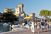 Sirmione on Lake Garda, Lombardy, Italy Ancient town and tourist centre Pleasure boat trips and the 13 C Scaliger Castle