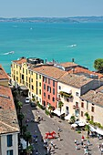 The holiday resort town of Sirmione on Lake Garda, Lombardy, Italy From the castle over Piazza Castello to Lago di Garda