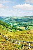 Sperrin Mountains, County Tyrone, Ireland North over Gortin village in valley of the Owenkillew River east of Newtownstewart
