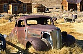 Abandoned vintage car automobile in the gold rush gold mining ghost town of Bodie in northern California, USA