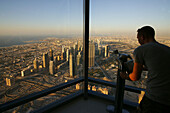 Man enjoying the view from the Observation Deck, At The Top, Burj Khalifa, Burj Chalifa, Sheikh Zayed Road, Dubai, United Arab Emirates, UAE