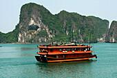 Red junk in bay, Ha Long Bay, Vietnam