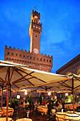 Piazza della Signoria - Palazzo Vecchio and restaurant at night, Florence, Tuscany, Italy