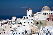White townscape with windmill, Oia, Santorini Island, Greek Islands