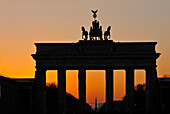 Brandenburg Gate in sunset glow, Berlin, Germany