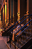 One man sitting on a staircase, Soho, Manhattan, New York City, New York, USA, North America, America