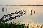 Fishing nets in twilight, Achterwasser, Krummin, Usedom, Mecklenburg-Western Pomerania, Germany